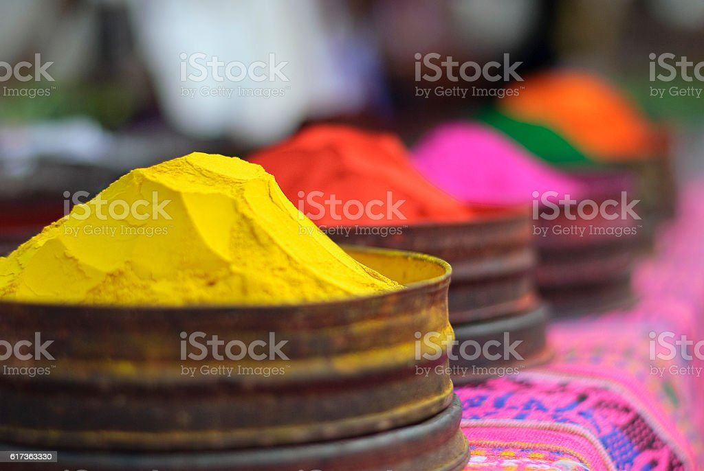 Bright color paint is sold at peruvian market stock photo