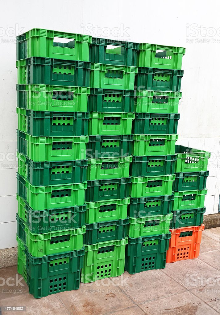 Bright Color Plastic Containers Piles beside supermarket stock photo