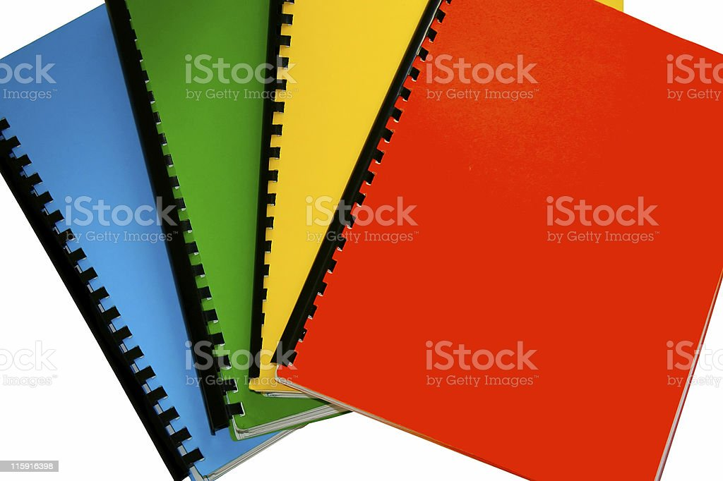 Bright colored books isolated on white stock photo