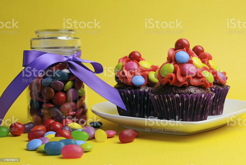 Bright colored cupcakes and candy jar. royalty-free stock photo
