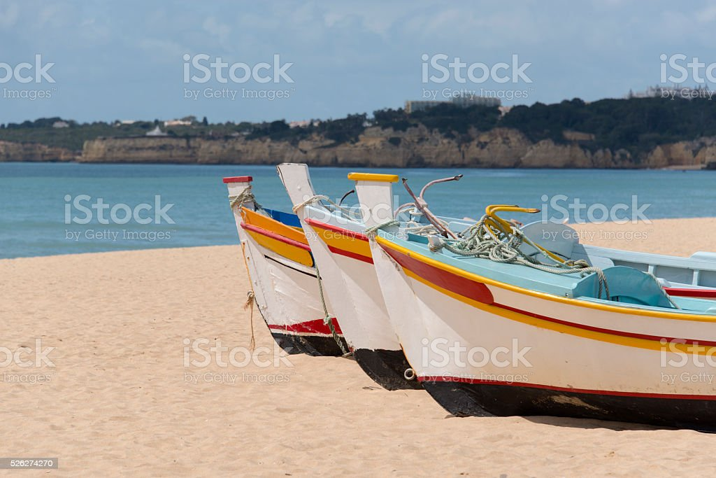 Bright colored fishing boats stock photo