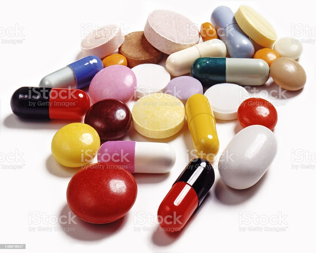 Bright colored tablets and capsules stock photo