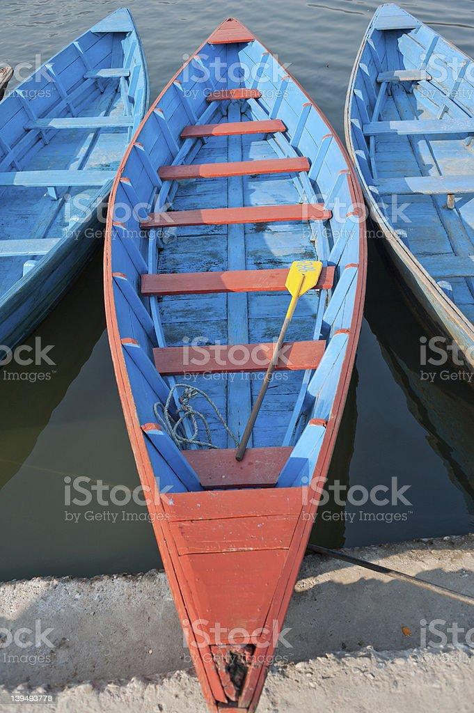 Bright colored wooden boats in Phewa Lake Pokhara royalty-free stock photo