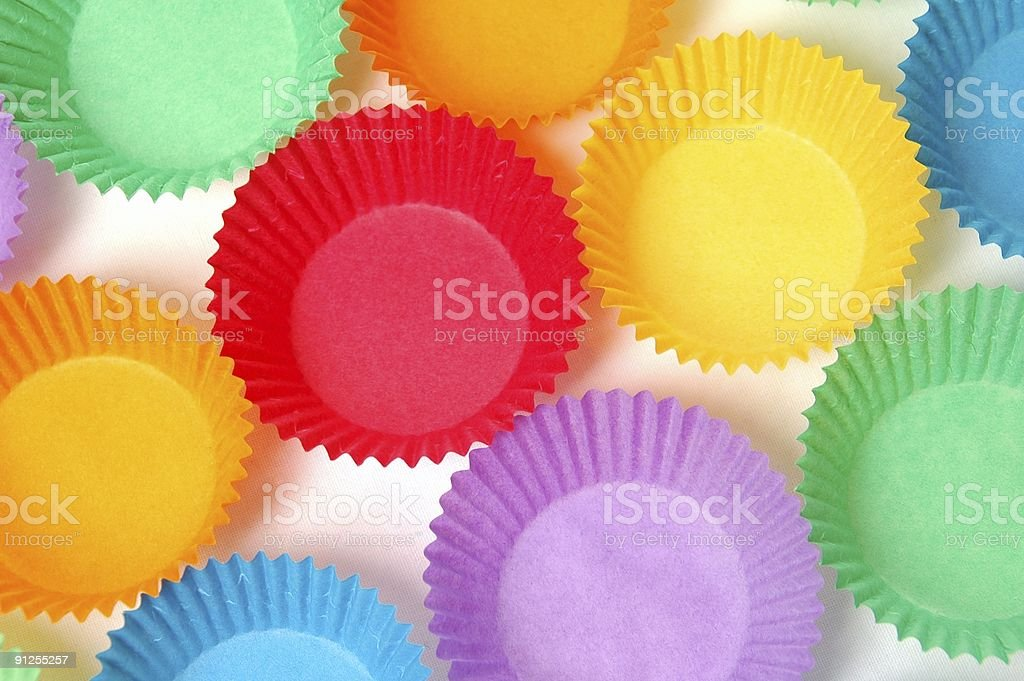 Bright colorful cupcake holders party concept stock photo