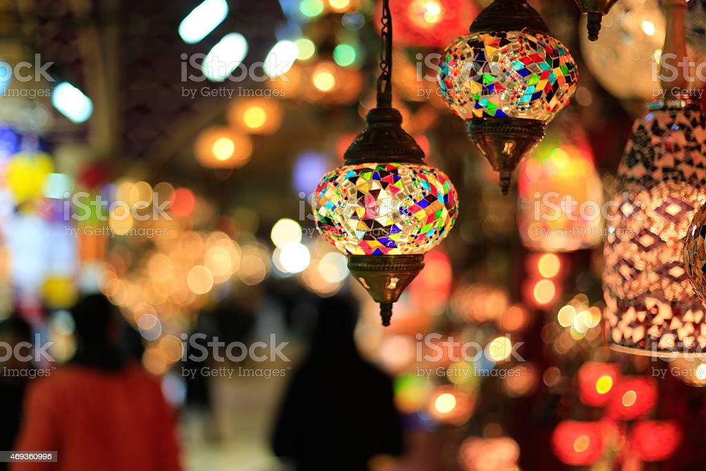 Bright, colorful lamps hung against blurred background stock photo