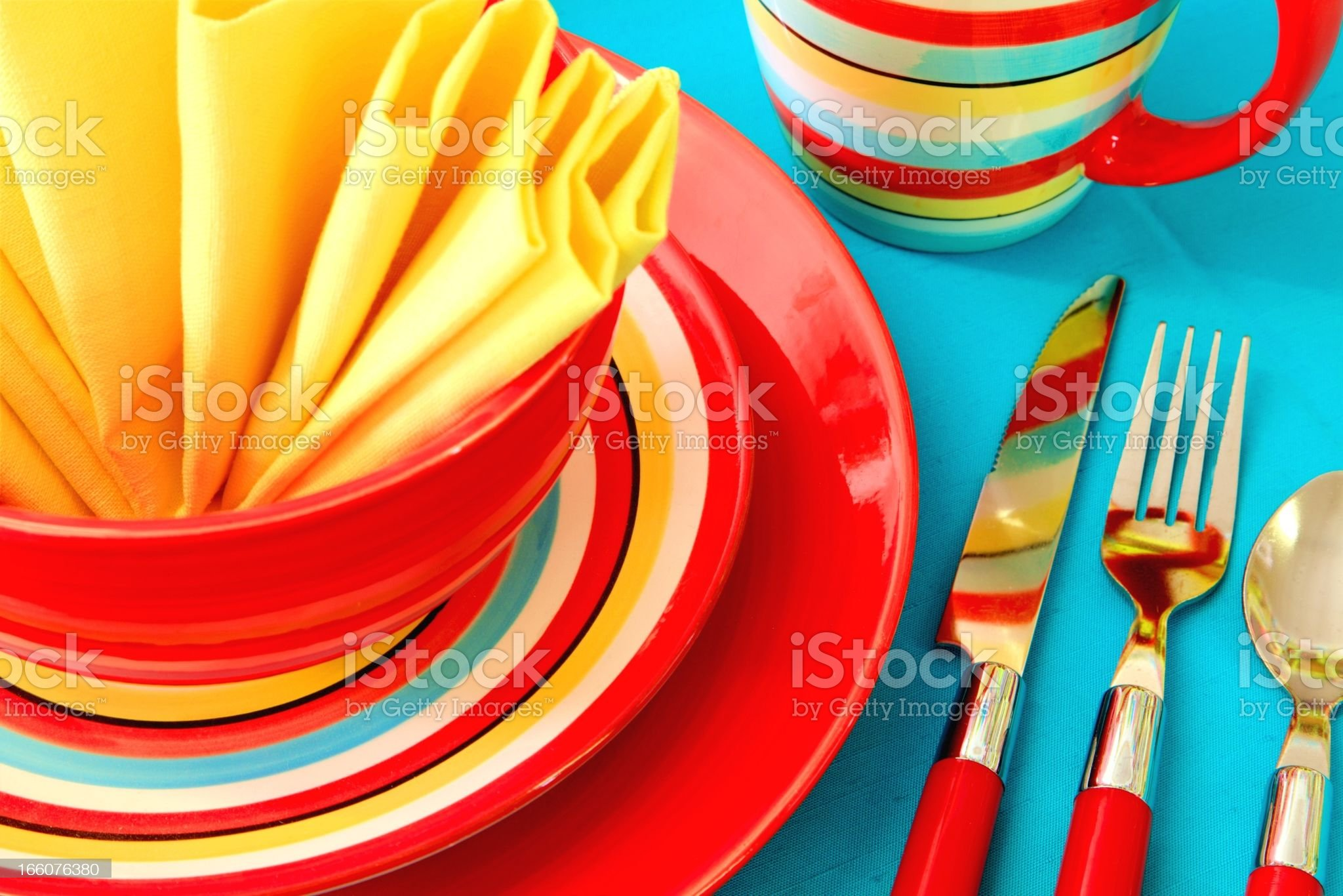 Bright Colorful Place Setting in red, yellow and turquoise royalty-free stock photo