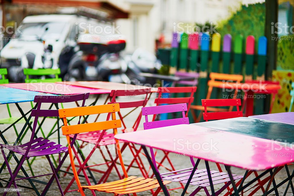 Bright colorful tables of Parisian outdoor cafe on Montmartre stock photo