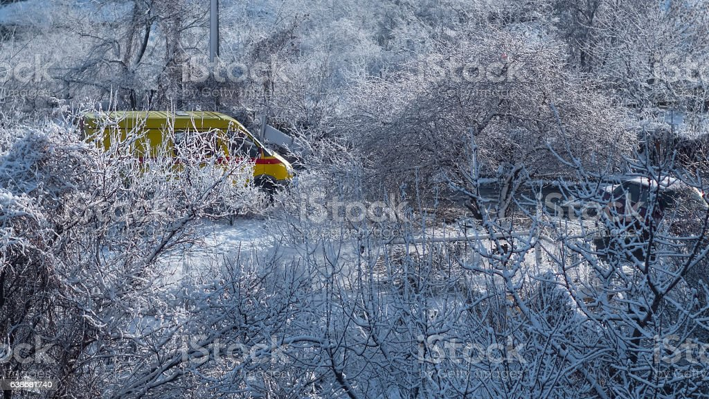 Bright colors car in a snowy yard stock photo