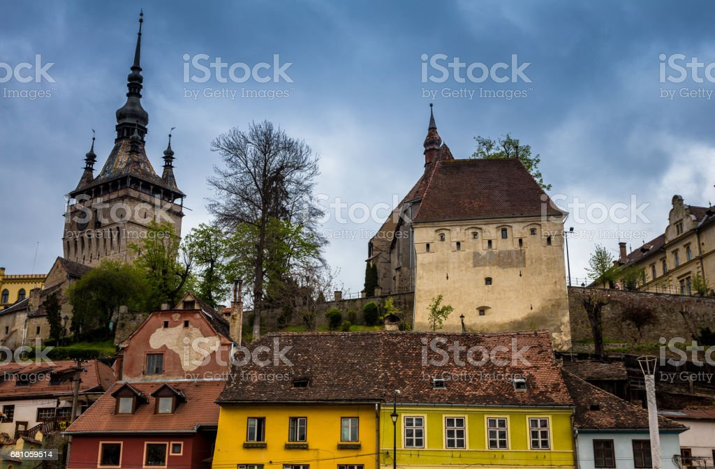 Bright coloured traditional architecture and clock tower in Sighisoara old town, Transylvania, Romania stock photo