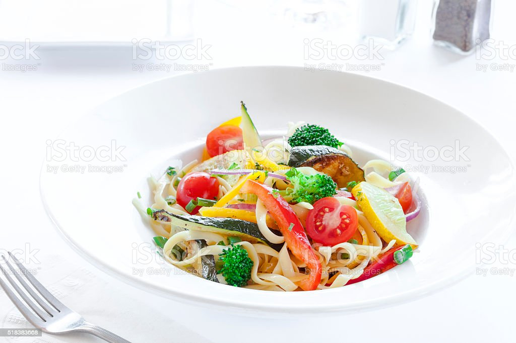 Bright, colourful healthy Vegetarian dish of pasta and vegetables. stock photo