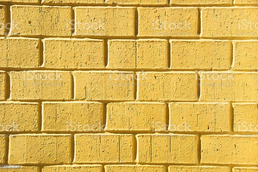 Bright Crisp Yellow Brick Wall Full Frame Horizontal royalty-free stock photo