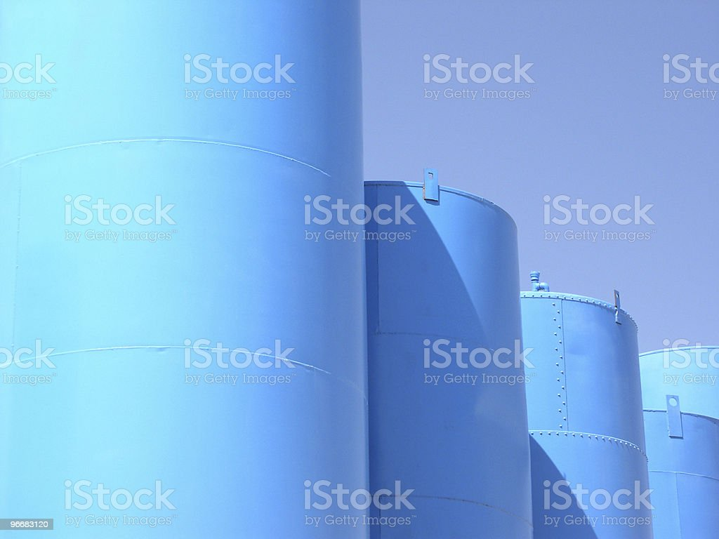 Bright day, blue sky, and tanks stock photo