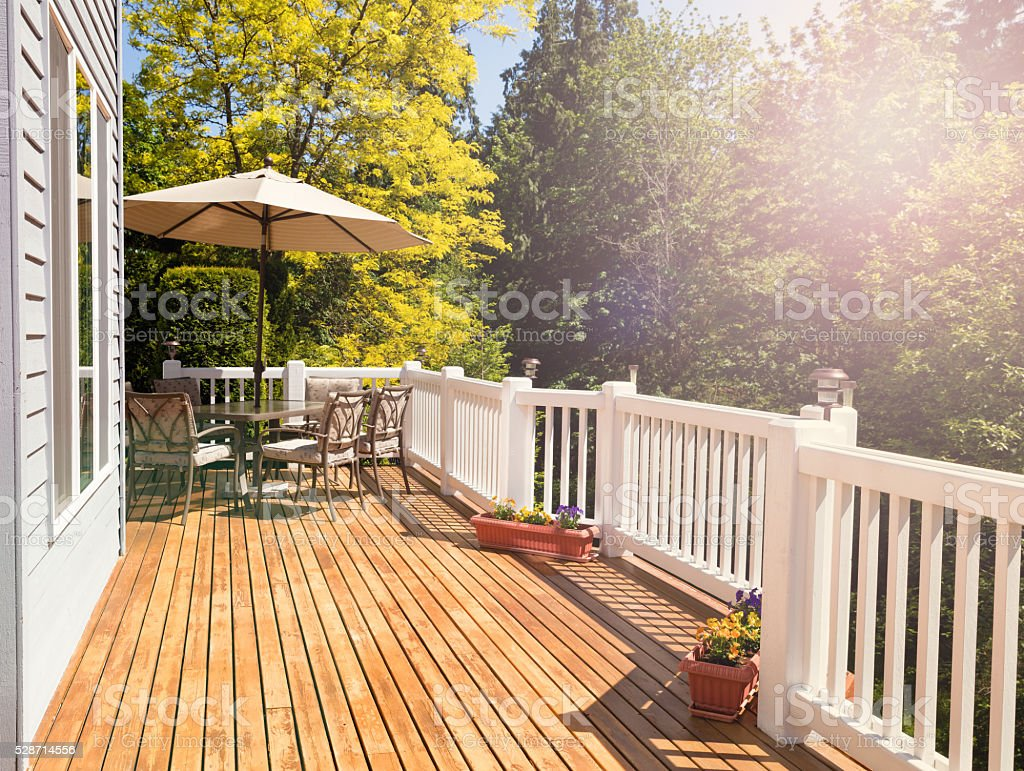 Bright daylight falling on home outdoor deck stock photo