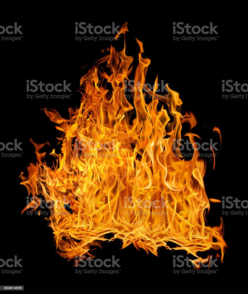 bright dense fire on black background stock photo
