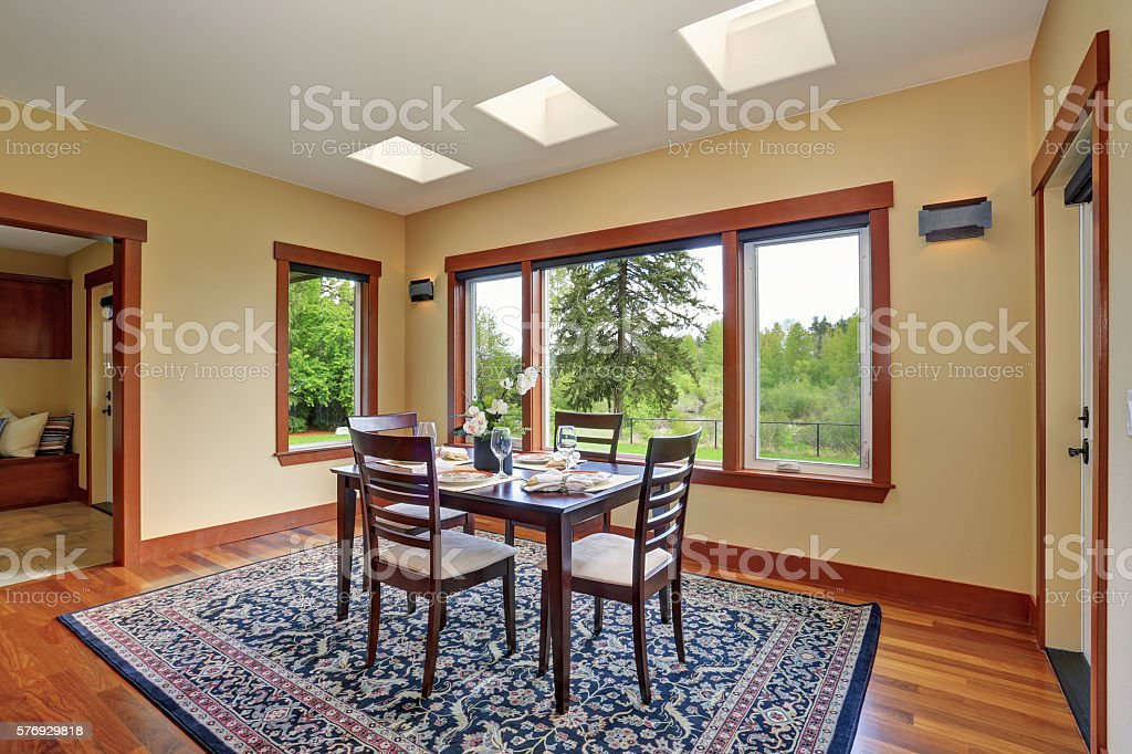 Bright dining room interior design with elegant table setting stock photo