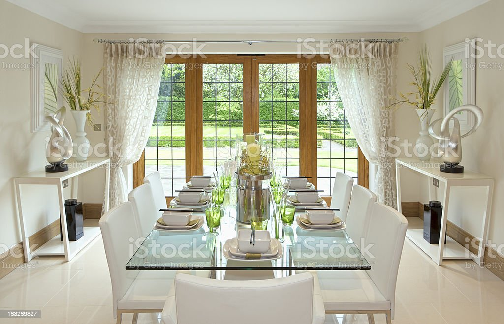 bright dining room with garden view royalty-free stock photo