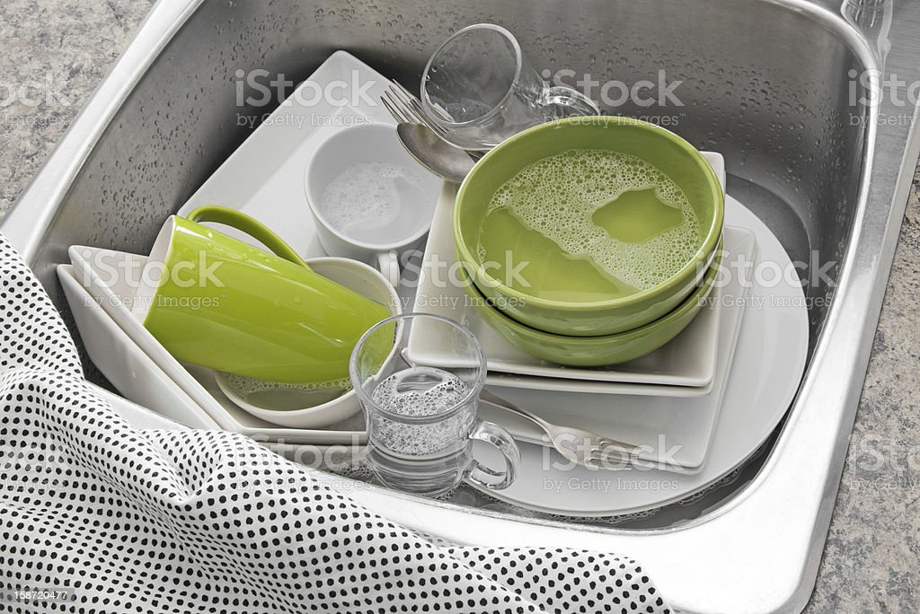 Bright dishes in the kitchen sink royalty-free stock photo