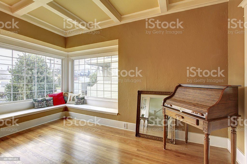 Bright empty room with an antique chest stock photo
