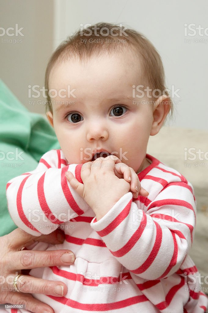 Bright eyed one year old girl looking stock photo
