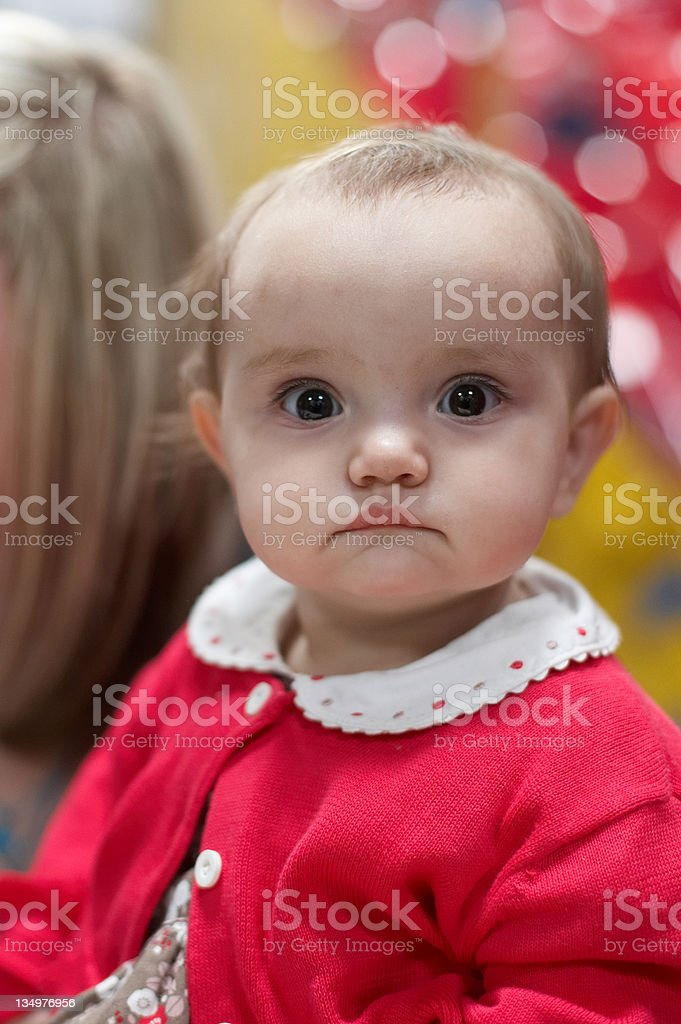 Bright eyed one year old girl stock photo