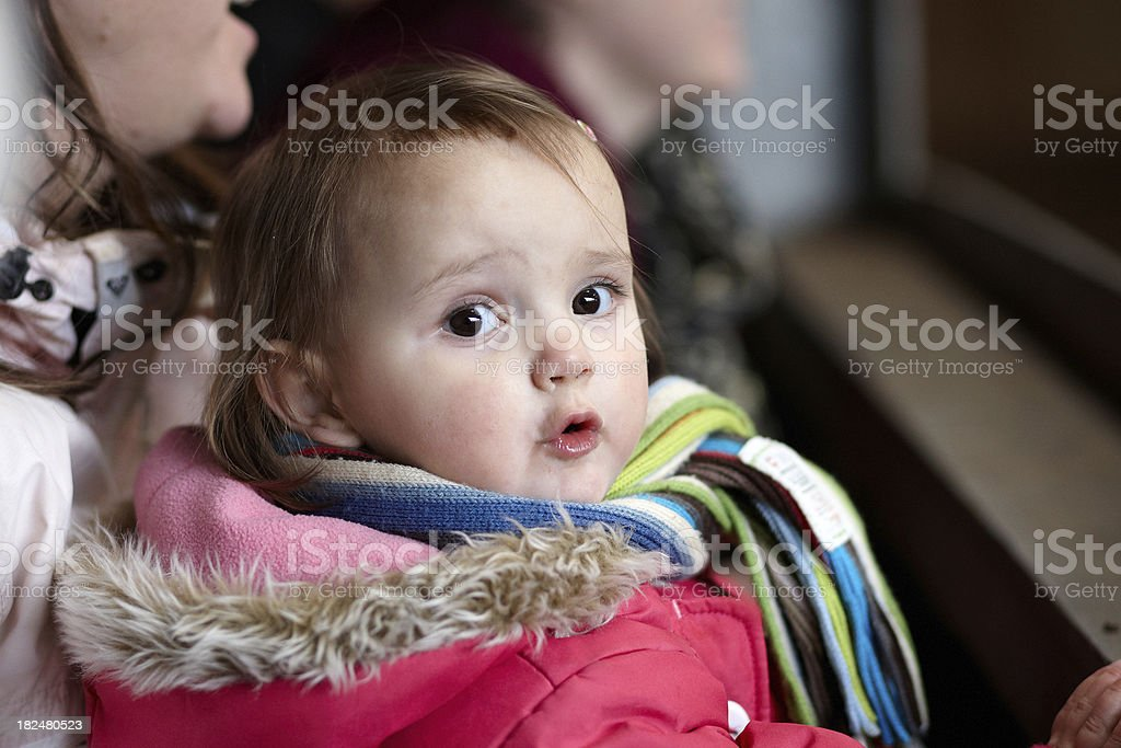 Bright eyed two year old girl in scarf stock photo