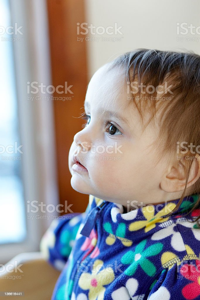 Bright eyed two year old girl stock photo
