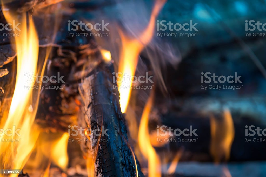 Bright flame of the burning bonfire close up stock photo