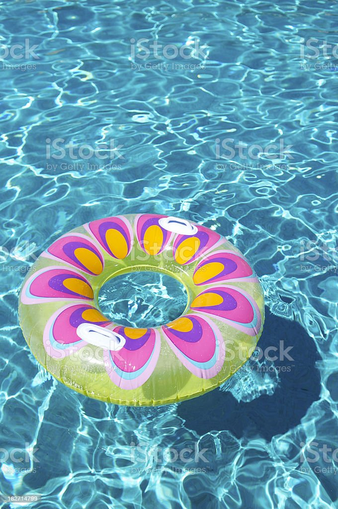 Bright Floaty Ring in Rippling Blue Pool royalty-free stock photo