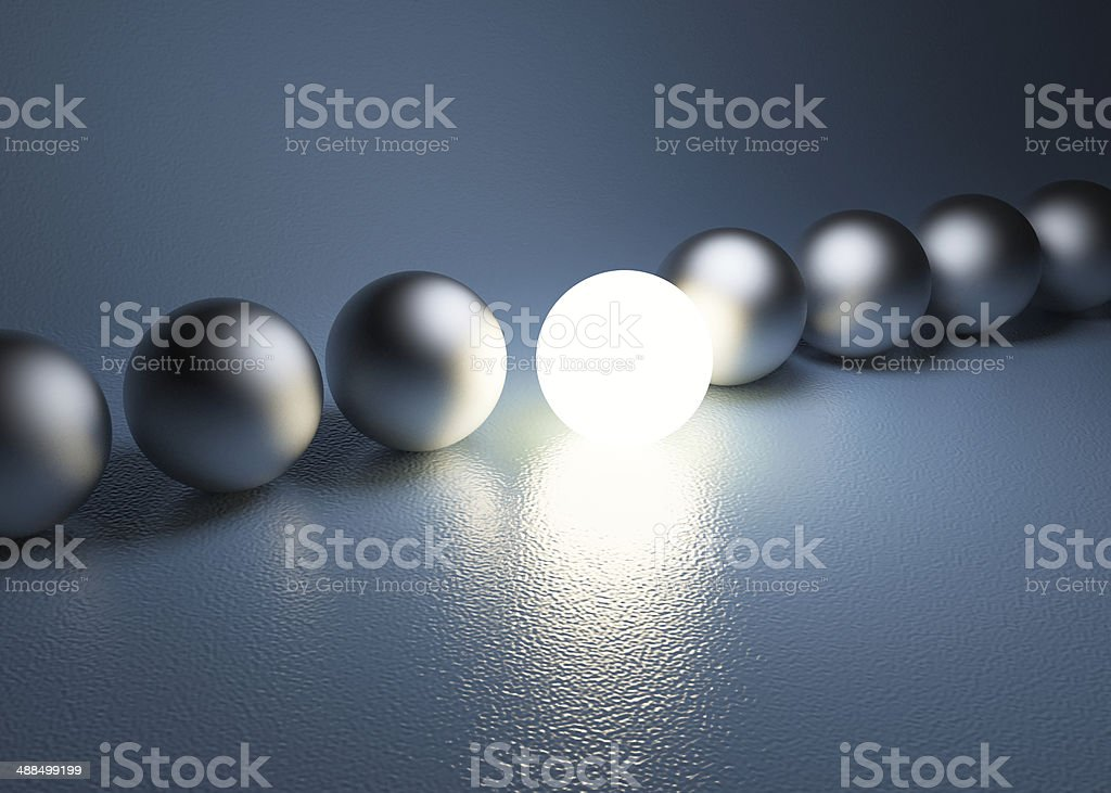 bright glowing sphere in a row. Leadership concept stock photo