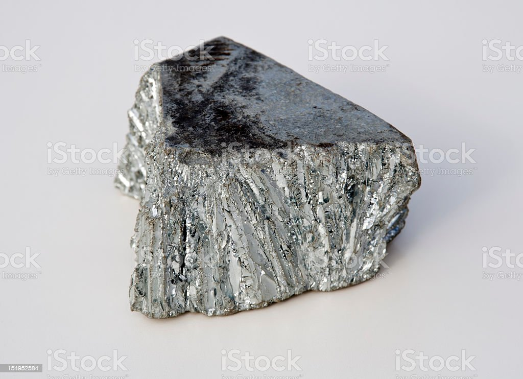 Bright gray zinc mine nugget on white background stock photo