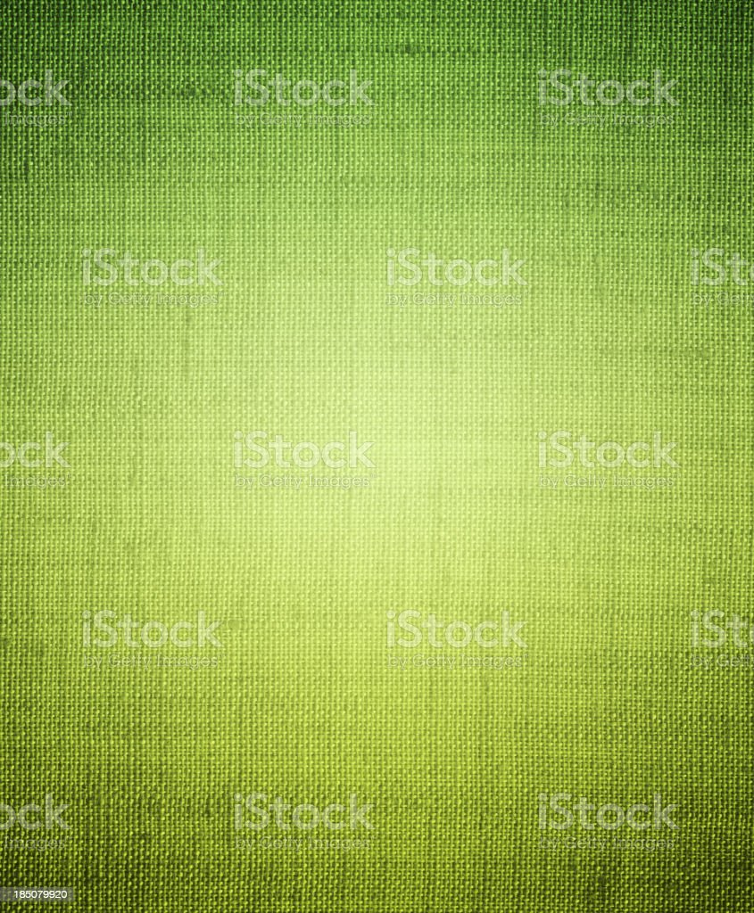 Bright green canvas-textured background stock photo