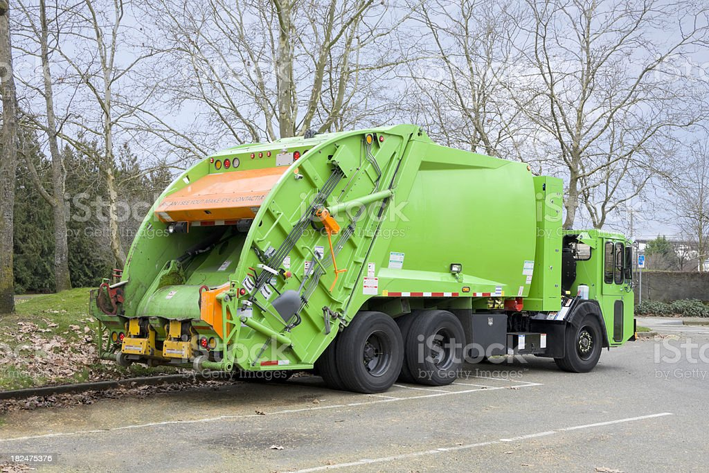 Bright Green Garbage Truck royalty-free stock photo