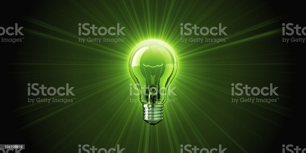 A bright green shining light bulb stock photo