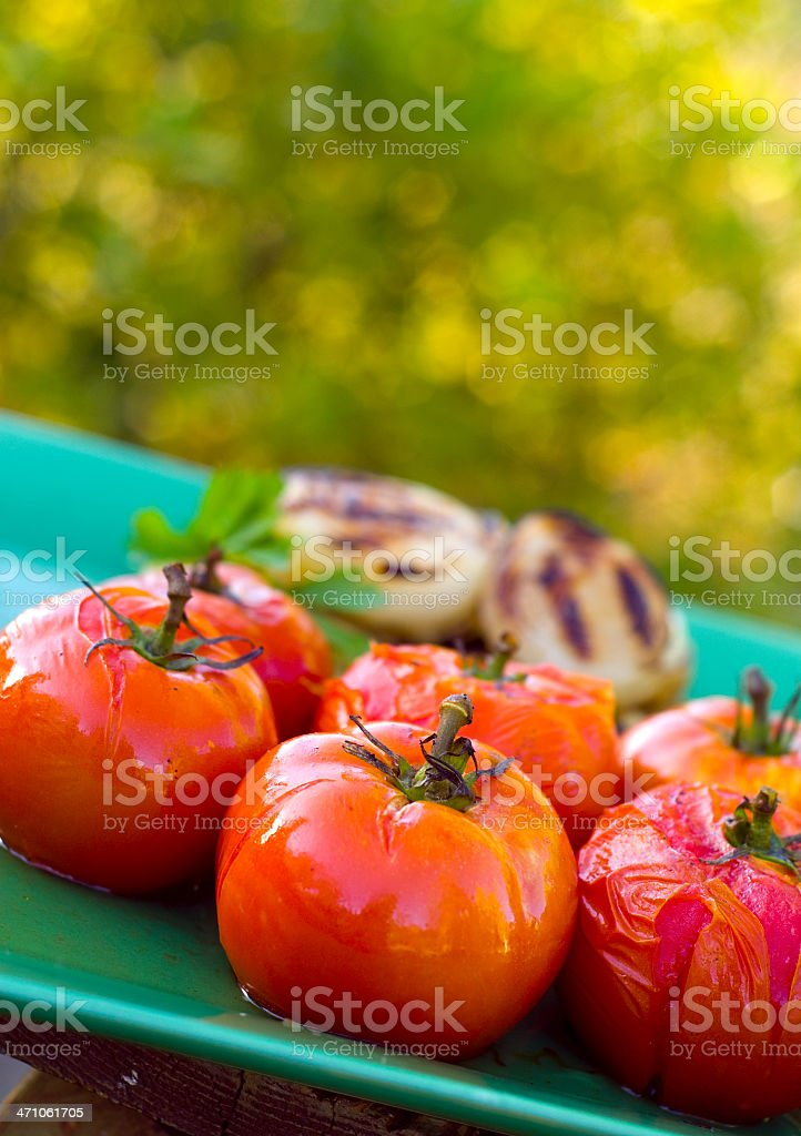 Bright Grilled Heirloom Tomatoes & Onions stock photo