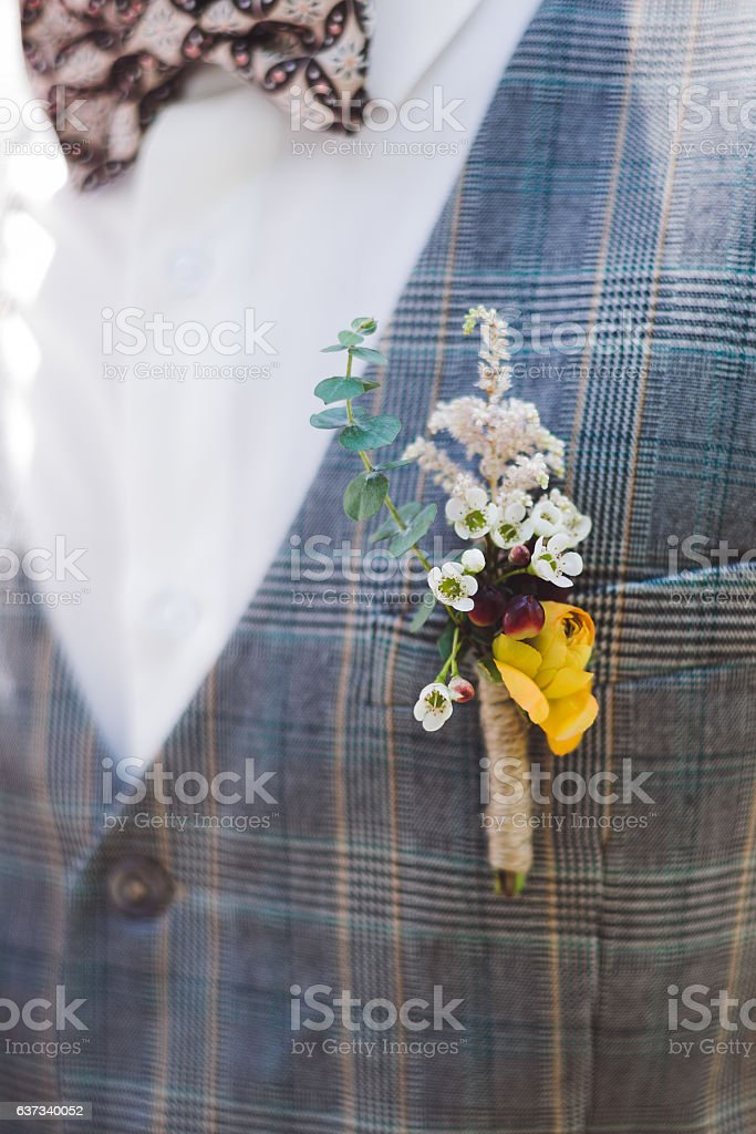 Bright groom boutonniere with yellow peony stock photo