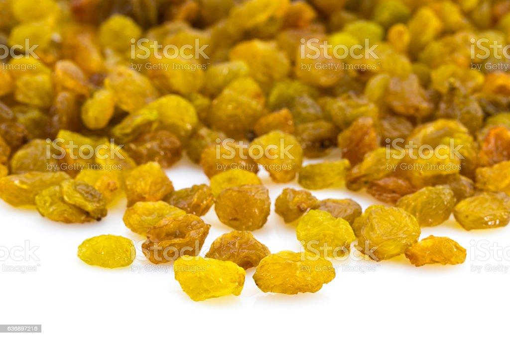 bright heap of raisins isolated on white background stock photo