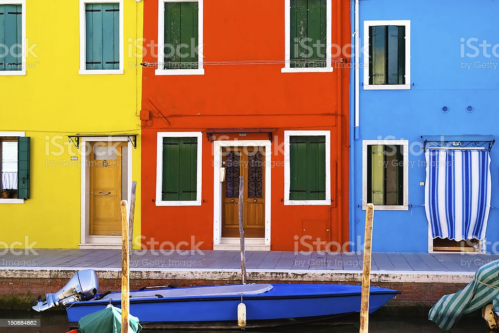 Bright houses in Burano: yellow, blue, red. royalty-free stock photo