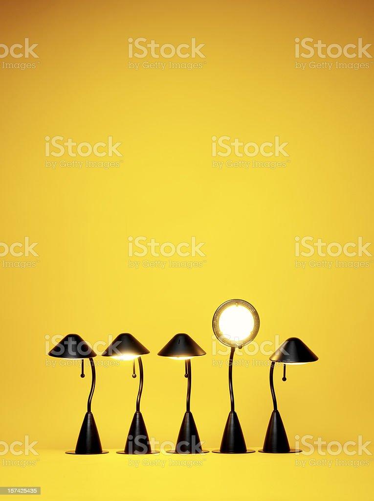 Bright Idea, Five desk lamps against yellow stock photo
