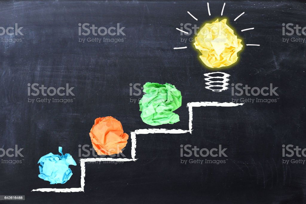 Bright idea on ladder steps stock photo