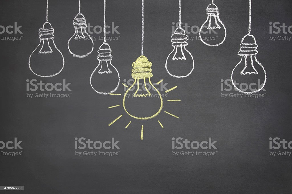 Bright Ideas Concept on Blackboard stock photo