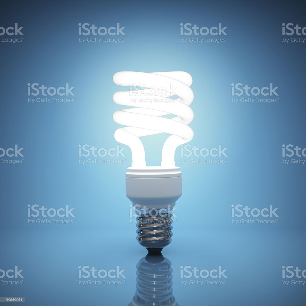 Bright, illuminated light bulb on blue background stock photo