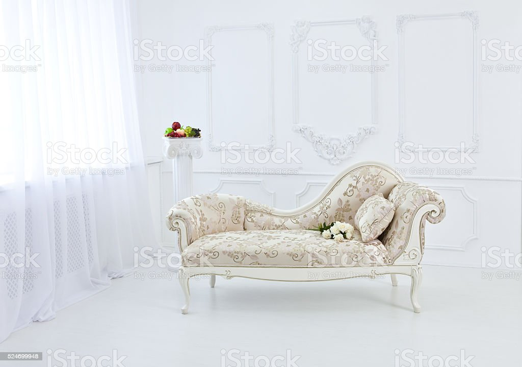 Bright interior of the Renaissance and Baroque with a couch. stock photo