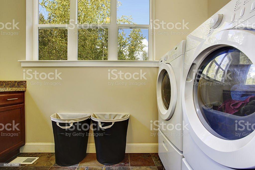 Bright ivory laundry room stock photo