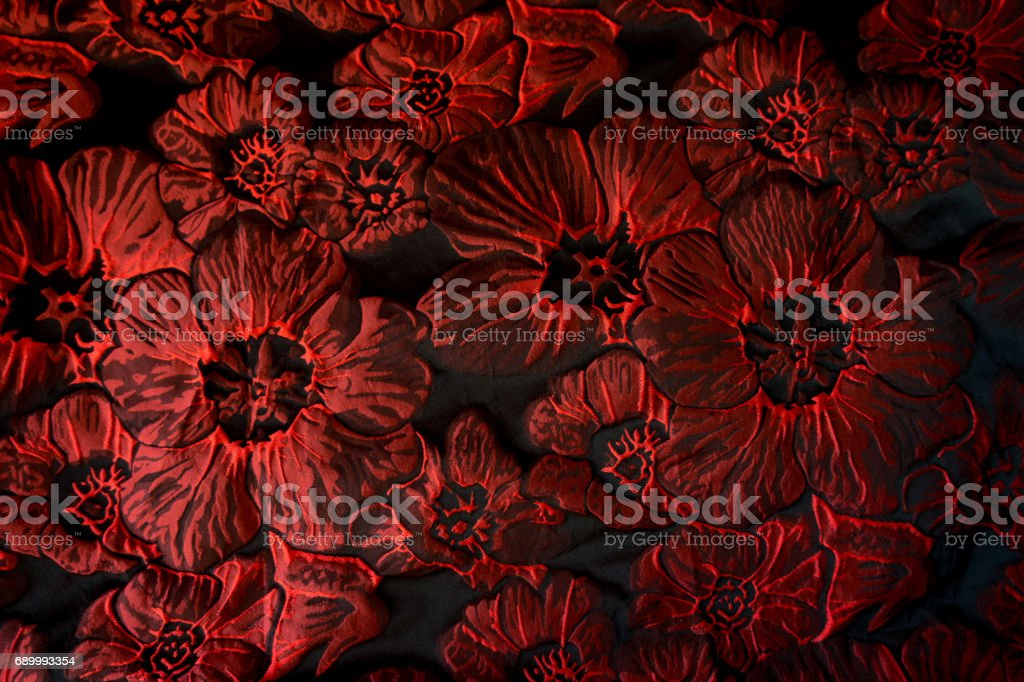 Bright jacquard fabric with floral pattern in black and red stock photo