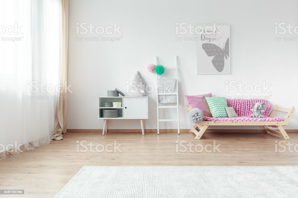 Bright kid room with colorful pillows stock photo