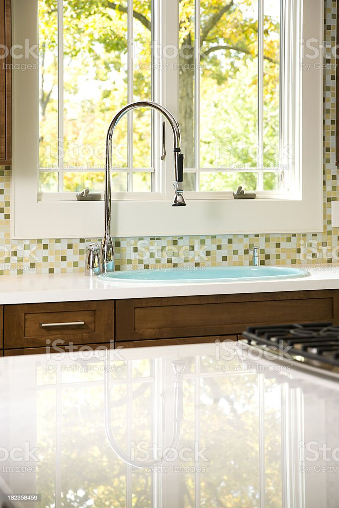 Bright kitchen window, faucet and sink. stock photo