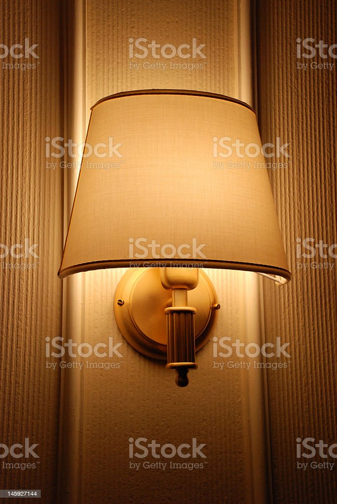 Bright lamp on hotel wall royalty-free stock photo