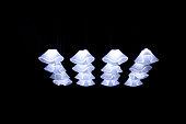 Bright Lamps shine in a black room