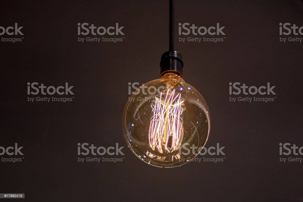 Bright light bulb turned on stock photo