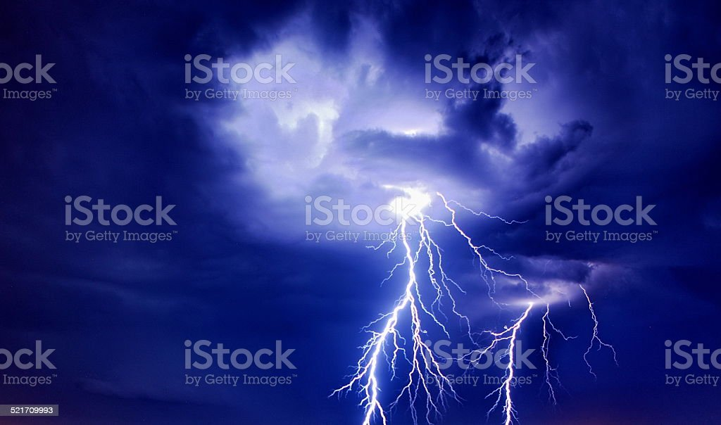 Bright lightning from the clouds stock photo
